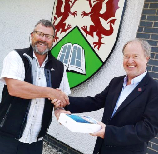 Professor Bryn Hubbard receiving the winning prize of an iPad from Gavin Rowlands, our Business Development Manager.